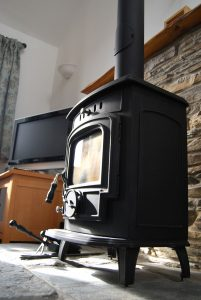 Woodburning stove at Long Linhay, Mortehoe, North Devon